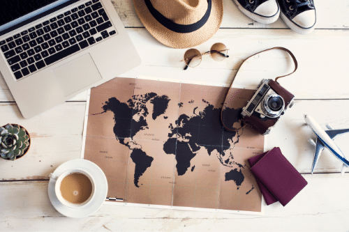 world map and travel gear